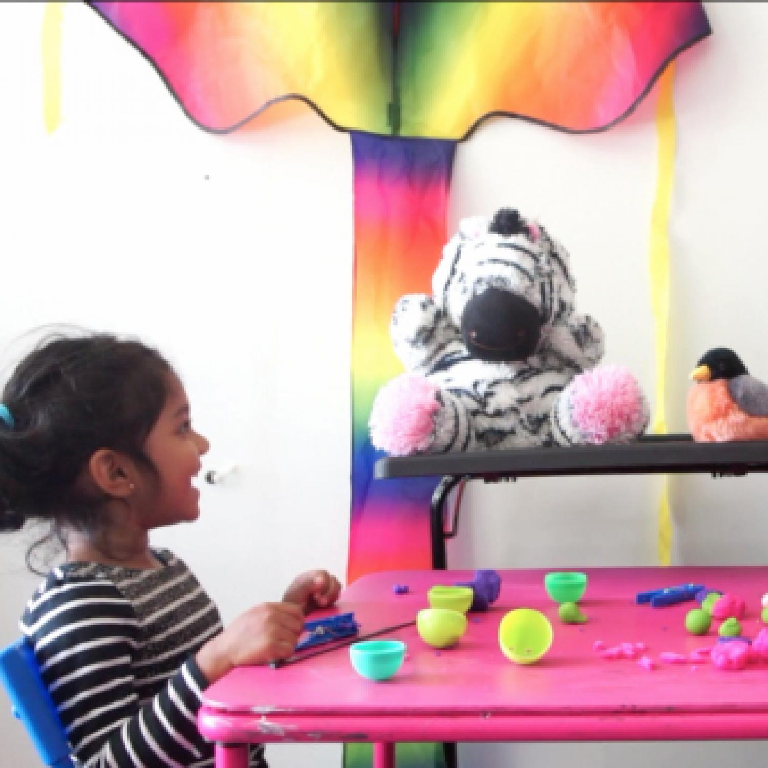 As preschoolers share their thoughts, the stuffed animal zebra asks them questions to deepen the story.