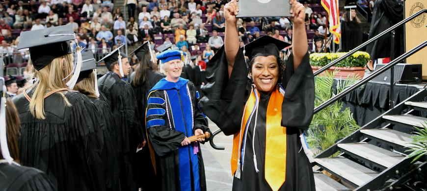 image: graduate with diploma