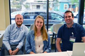 Nick Arlas, SOM student, Kylie Van Hoesen, a pre-med student at DU, and Nathan Davis, a student at the Graduate School at CU file into the clinic early to help patients check in.
