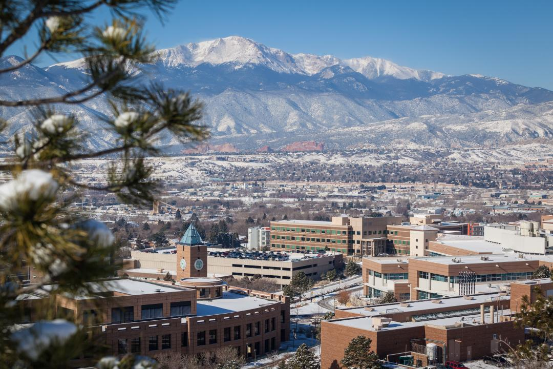 High-angle winter photo of the UCCS campus with the mountains in the background.